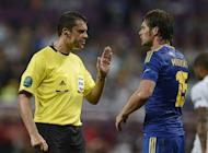 Hungarian referee Viktor Kassai gestures to Ukrainian forward Artem Milevskiy during the Euro 2012 football championships match England vs Ukraine on June 19, at the Donbass Arena in Donetsk. Kassai on Thursday admitted that he should have awarded a goal to Ukraine in their final Euro 2012 match against England and apologised for his mistake