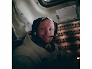 Neil Armstrong sits in the lunar module after a historic moonwalk.