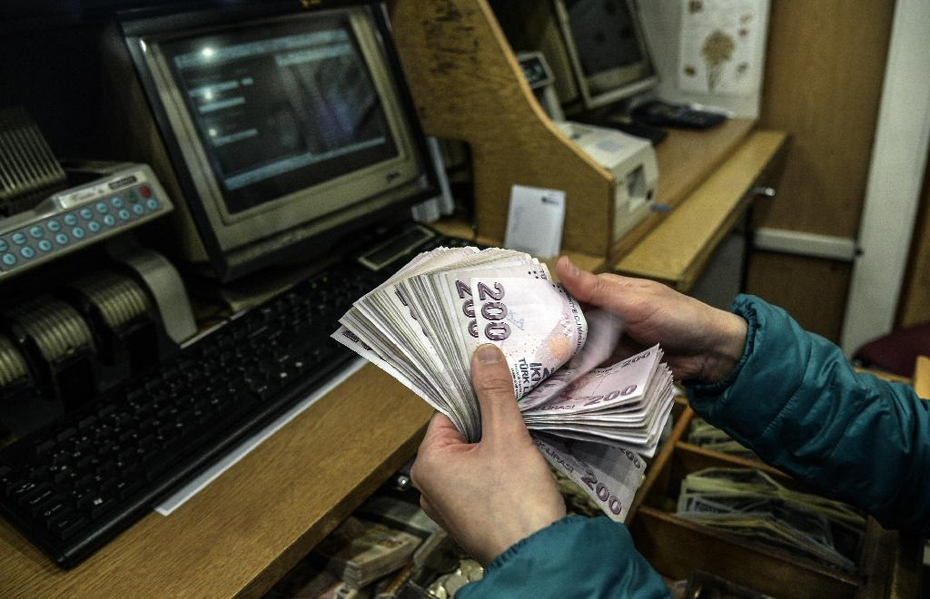 Turkish lira hits new record low on rate cut expectations