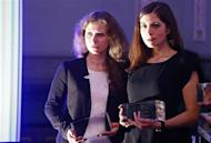 "Russian punk band Pussy Riot members Maria Alyokhina (L) and Nadezhda Tolokonnikova pose after winning a trophy in the category ""Most Valuable Documentary of the Year"" at the ""Cinema for Peace"" charity gala in Berlin February 10, 2014. REUTERS/Tobias Schwarz"