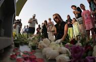 Mourners gathered at the 'Aspire Zone' in the Qatari capital, Doha, close to the scene where two-year-old New Zealand triplets among 19 in total perished in a massive fire that tore through a nursery on May 29. Qatar has ordered the arrest of five people involved in the management of the shopping mall ravaged by the fire, the state news agency reported