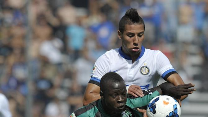 Sassuolo's Yussif Raman Chibsah, of Ghana, left, vies for the ball with Inter Milan's Saphir Taider, of Algeria, during their Serie A soccer match at Reggio Emilia's Mapei stadium, Italy, Sunday, Sept. 22, 2013