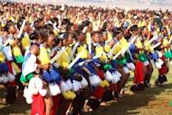 """File picture shows unmarried women from Swaziland dance for Africa's last absolute monarch, King Mswati III (unseen) near the capital Mbabane, on August 29, 2011, during the traditional """"Umhlanga"""" ceremony known as the annual Reed Dance. Mswati introduced his 14th fiancee Sindiswa Dlamini at a Reed Dance celebration over the weekend, a palace spokesman told AFP on Tuesday."""