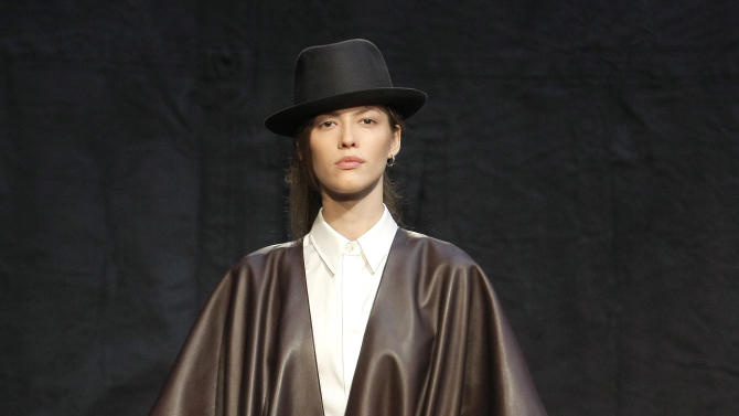 A model wears a creation by Hermes as part of the Fall-Winter, ready-to-wear 2013 fashion collection, during Paris Fashion week, Sunday, March 4, 2012. (AP Photo/Thibault Camus)