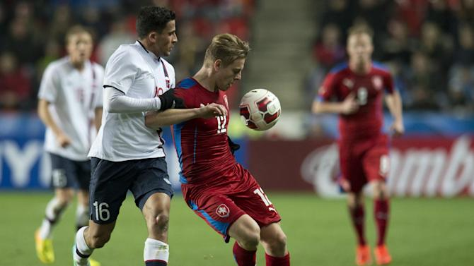 Omar Elabdellaoui from Norway, left, fights for the ball with Matej Vydra from the Czech Republic, right, during their friendly soccer match in Prague, Czech Republic, Wednesday, March 5, 2014. (AP Photo,CTK/Michal Kamaryt)