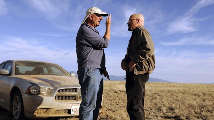 "This 2012 photo released by AMC shows cinematographer Michael Slovis, left, and Bryan Cranston on the set of ""Breaking Bad."" The series finale will air on Sunday, Sept. 29. (AP Photo/AMC, Ursula Coyote)"