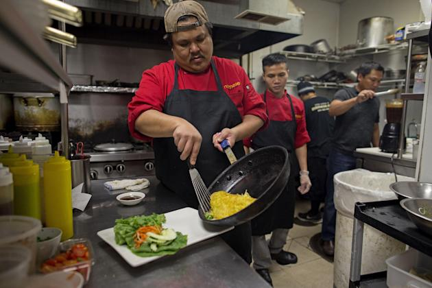 """Food is prepared in the kitchen at """"Namese""""  in New Orleans, Monday, Aug. 17, 2015, a Vietnamese restaurant, which infuses the famous flavors of New Orleans with traditional Asian favorites. New Orlea"""