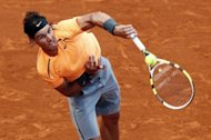 Spain's Rafael Nadal hits a return to Kazakhstan's Mikhail Kukushkin during the Monte-Carlo ATP Masters Series Tournament tennis match, in Monaco. Nadal won 6-1, 6-1 in exactly one hour