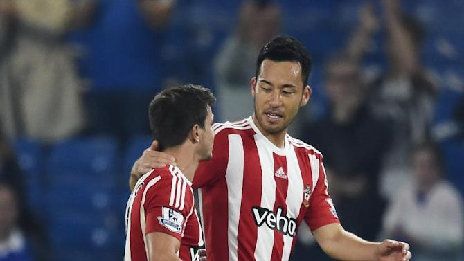 Southampton's Cedric Soares (L) and Maya Yoshida celebrate at the end of the match