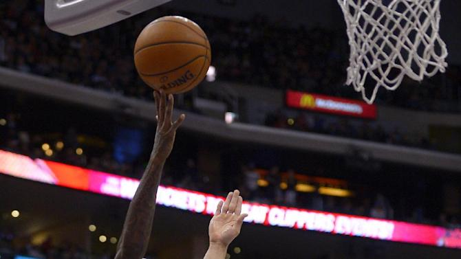 Los Angeles Clippers guard Jamal Crawford, left, puts up a shot as Utah Jazz center Enes Kanter, of Turkey, defends during the second half of an NBA basketball game, Saturday, Feb. 1, 2014, in Los Angeles