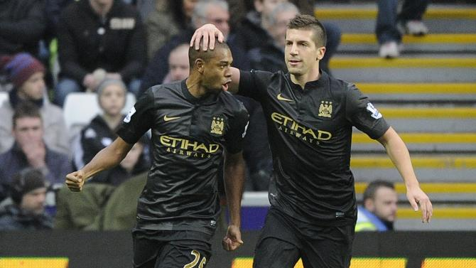 Manchester City's Fernandinho celebrates scoring a goal against Swansea City with Nastasic during their English Premier League soccer match in Swansea