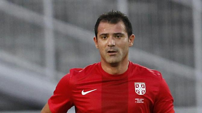 Sebia's Dejan Stankovic controls the ball during an international friendly soccer match against Japan, at Karadjordje stadium in Novi Sad, Serbia, Friday, Oct. 11, 2013. Stankovic has played for Red Star Belgrade (1994-1998), Lazio (1998-2004) and Inter Milan (2004-2013)