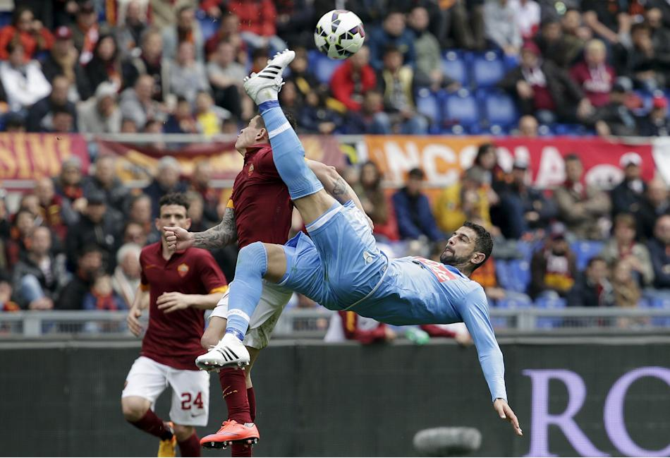 Napoli's Britos tries an overhead kick as he challenges AS Roma's Iturbe during their Serie A soccer match at the Olympic stadium in Rome