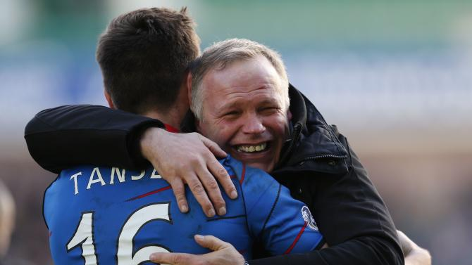 Inverness Caledonian Thistle's manager John Hughes celebrates with Greg Tansey, his sides victory over Hearts after their Scottish League Cup semi final soccer match in Edinburgh