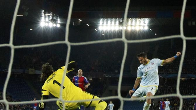 Steaua Bucharest's Piovaccari scores past FC Basel's Sommer during Champions League soccer match in Basel