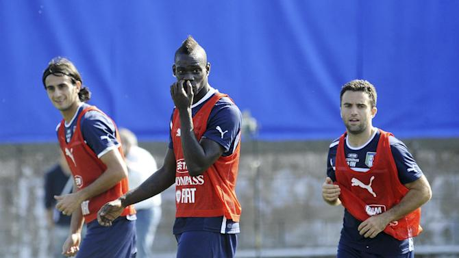 From left, Italy's Alberto Aquilani, Mario Balotelli and Giuseppe Rossi, during a training session with their team at the Giarrusso stadium in the outskirts of Naples, Monday, Oct. 14, 2013, ahead of a 2014 FIFA World Cup, Group B, qualification match against Armenia in Naples on Tuesday.  Other teams in Group B are, Denmark, Bulgaria, Czech Republic, and Malta