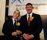 Gaming tycoons Lawrence Ho (L) of Macau and James Packer (R) of Australia pose in Manila on March 15, 2013 during the launch of a casino project in the Philippines