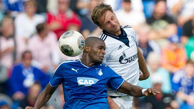 Schalke' s Benedikt Hoewedes, right, and Hoffenheim's Anthony Modeste challenge for the ball during the German first division Bundesliga soccer match between TSG 1899 Hoffenheim and Schalke 04 in Sinsheim, Germany, Saturday, Sept. 28, 2013