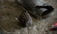 A granede lies on the floor next to a sandal inside the building where Taliban militants launched an attack in Kabul. The Pentagon has said a major attack on Afghan government buildings, military bases and foreign embassies was likely carried out by Haqqani militants who operate from sanctuaries in neighboring Pakistan