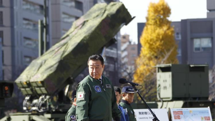 Japanese Prime Minister Yoshihiko Noda, standing by a ground-based Patriot Advanced Capability-3 interceptor, looks back as he speaks during his inspection tour to the Defense Ministry in Tokyo Friday, Dec. 7, 2012. Japan deployed the PAC-3 system on the ministry compound in the middle of Tokyo to prepare for North Korea's planned launch of a long-range rocket starting Monday, Dec. 10. (AP Photo/Koji Sasahara)