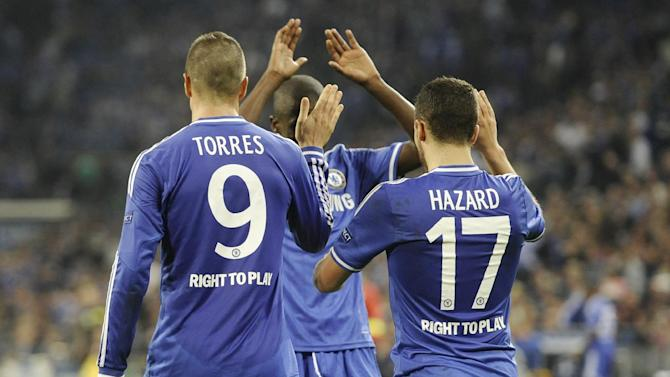 Chelsea's double scorer Fernando Torres, left, and his teammate Eden Hazard are congratulated by Ramires after Hazard scored their side's third goal during the Champions League group E soccer match between FC Schalke 04 and Chelsea FC in Gelsenkirchen, Germany, Tuesday, Oct. 22, 2013