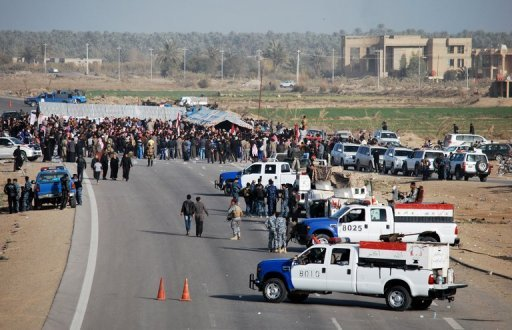 "Iraqi protesters demanding the ouster of premier Nuri al-Maliki block a highway in western Iraq leading to Syria and Jordan, in Ramadi on December 23, 2012. Maliki looked to head off protests in Sunni areas of the country on Tuesday with a prisoner release even as he threatened to use state resources to ""intervene"" to end the rallies"