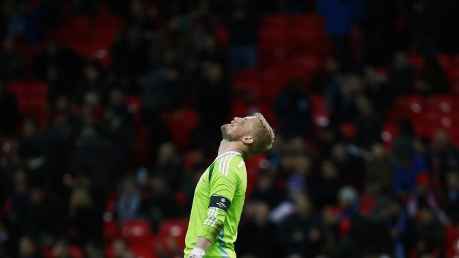 Denmark's goalkeeper Schmeichel reacts after conceding a goal by England's Sturridge during their international friendly soccer match at Wembley stadium in London