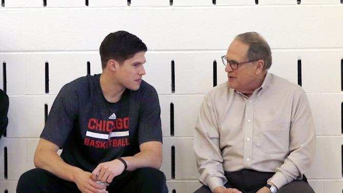 Jerry Reinsdorf, right, Chairman of the Chicago Bulls, talks with player Doug McDermott before an NBA basketball news conference where Fred Hoiberg was introduced as the team's new head coach, Tuesday, June 2, 2015, in Chicago. (AP Photo/Charles Rex Arbogast)