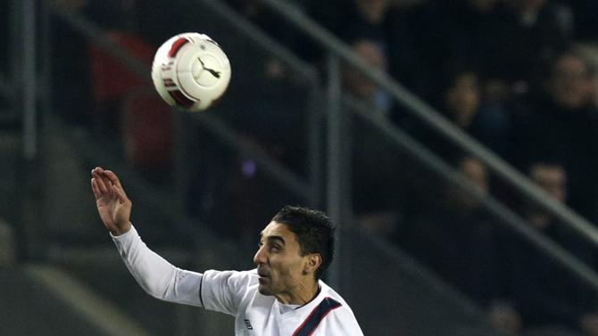 Czech Hubschman and Norway's Abdellaoue jump for the ball during their international friendly soccer match in Prague