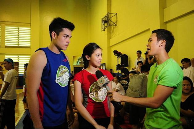 Xian Lim and Kim Chiu take a break from the games as they are interviewed by ABS-CBN's MJ Felipe during the Star Magic Games held at the Celebrity Sports Club in Quezon City on 29 July 2012.