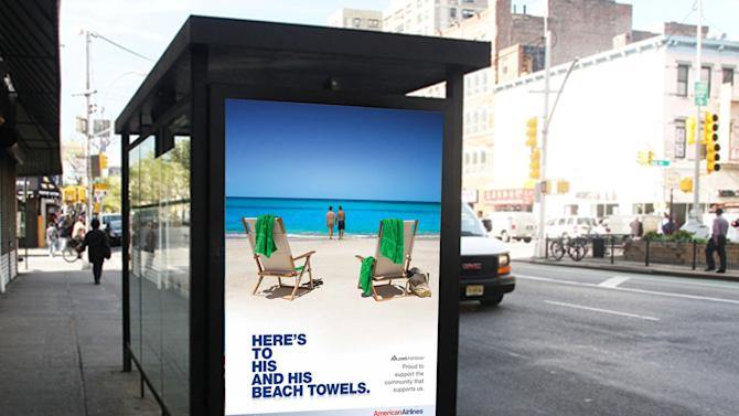 """This 2010 image released by American Airlines shows a travel ad for American Airlines showing two men on a beach displayed at a bus stop shelter in New York.  The slogan reads, """"Here's to his and his beach towels."""" and follows with, """"Proud to support the community that supports us."""" Welcome to the latest in gay imagery in mainstream advertising, where LGBT people have been waiting for a larger helping of fairness and accuracy, on screen and in print, or at least something other than punchlines and cliches to sell stuff at their expense. (AP Photo/American Airlines)"""
