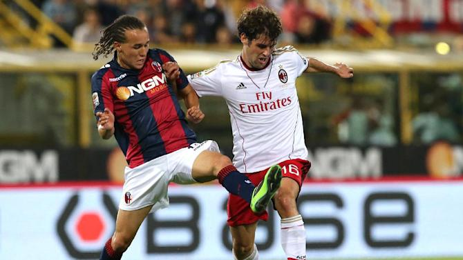 AC Milan midfielder Andrea Poli, left, and Bologna midfielder Diego Laxalt, of Uruguay, vie for the ball during a Serie A soccer match at Bologna's Renato Dall'Ara stadium, Italy, Wednesday, Sept. 25, 2013