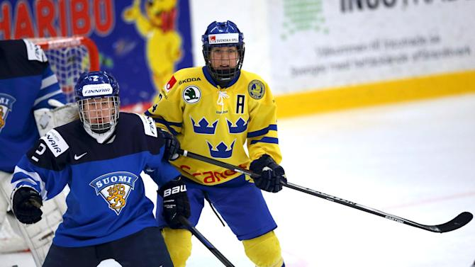 Finland's Eve Savander and Sweden's Erika Grahm are pictured in action during their Pre Game WCS Women ice hockey match in Trelleborg