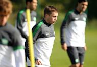 Celtic's midfielder James Forrest (C) takes part in a training session at Lennoxtown training facility near Glasgow, Scotland, on September 18, 2012. Neil Lennon says Forrest is irreplaceable after watching him score on his comeback from a seven-week injury layoff against Ross County on Saturday