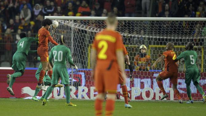 Belgium's Fellaini heads the ball to score a goal against Ivory Coast during their international friendly soccer match at King Baudouin Stadium in Brussels