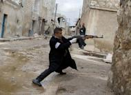 A Syrian rebel aims his weapon during clashes with government forces near Aleppo international airport, on March 4, 2013