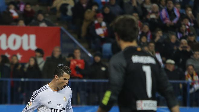 Real's Cristiano Ronaldo cerebrates his goal during a semi final, 2nd leg, Copa del Rey soccer match between Atletico de Madrid and Real Madrid at the Vicente Calderon stadium in Madrid, Spain, Tuesday, Feb. 11, 2014