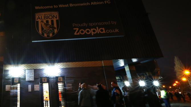 West Bromwich Albion fans gather below a Zoopla sign before their English Premier League soccer match against Everton at the Hawthorns in West Bromwich