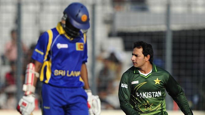 Pakistani bowler Saeed Ajmal (R) reacts after the dismissal of Sri Lankan batsman Upul Tharanga (L) during the one day international (ODI) Asia Cup cricket match between Pakistan and Sri Lanka at The Sher-e-Bangla National Cricket Stadium in Dhaka on March 15, 2012. AFP PHOTO/Munir uz ZAMAN (Photo credit should read MUNIR UZ ZAMAN/AFP/Getty Images)