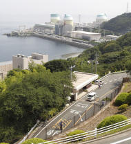 This Saturday, July. 23, 2011 photo shows the Ikata nuclear power plant and its compound operated by Shikoku Electric Power Co. in Ikata, western Japan. The facility is one of the world's most seismologically risky plants. Many in Japan have grown uneasy with nuclear power since the March 11, 2011 tsunami, which sent the Fukushima Dai-Ichi plant into meltdown. Yet six months after the disaster, Japan seems to feel it has little choice but to live with nuclear power, at least for now. (AP Photo/Koji Sasahara)