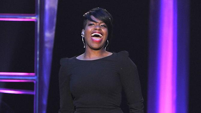FILE - This Nov. 8, 2012 file photo shows singer Fantasia performing at the Soul Train Awards at Planet Hollywood Resort and Casino in Las Vegas. Fantasia, Donnie McClurkin, Marvin Winans and Bishop Paul S. Morton will perform during a gospel concert during Super Bowl weekend in New Orleans. (Photo by Jeff Bottari/Invision/AP, file)