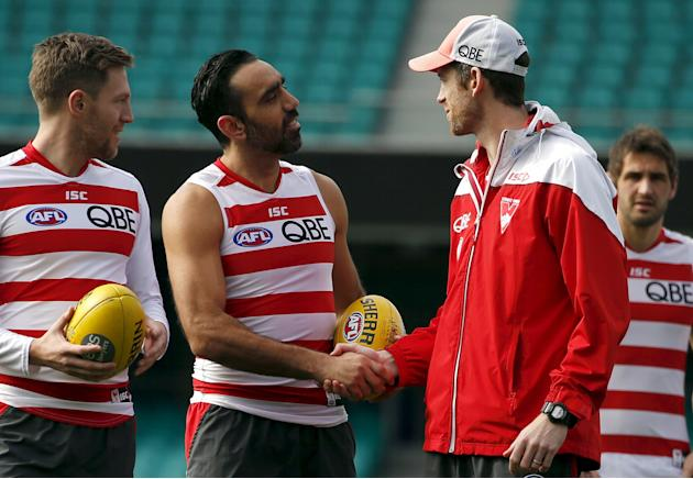 Aboriginal activist and Australian Rules Football legend Goodes shakes hands with team mates during a team training session at the Sydney Cricket Ground
