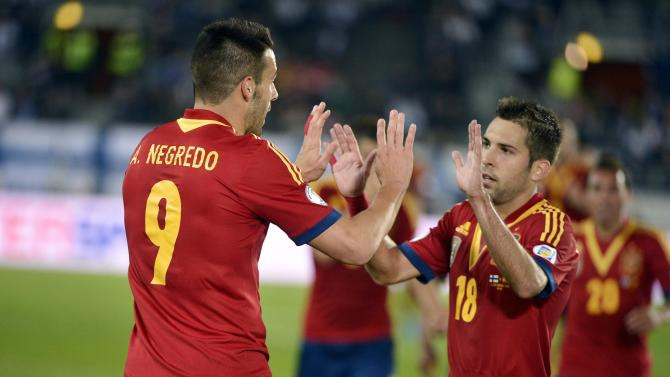 Goal scorers for Spain, Negredo and Alba celebrate during their 2014 World Cup qualifying soccer match against Finland in Helsinki