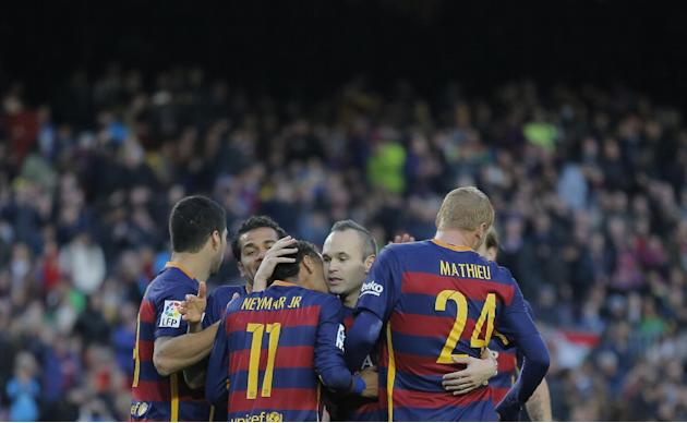 FC Barcelona's Neymar, center left, celebrates with his teammates after scoring against Real Sociedad during a Spanish La Liga soccer match at the Camp Nou stadium in Barcelona, Spain, Saturday, N