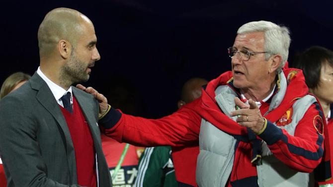 Bayern head coach Pep Guardiola of Spain, left, and Guangzhou Evergrande's coach Marcello Lippi of Italy arrive for their semi final soccer match between Guangzhou Evergrande FC and FC Bayern Munich at the Club World Cup soccer tournament in Agadir, Morocco, Tuesday, Dec. 17, 2013