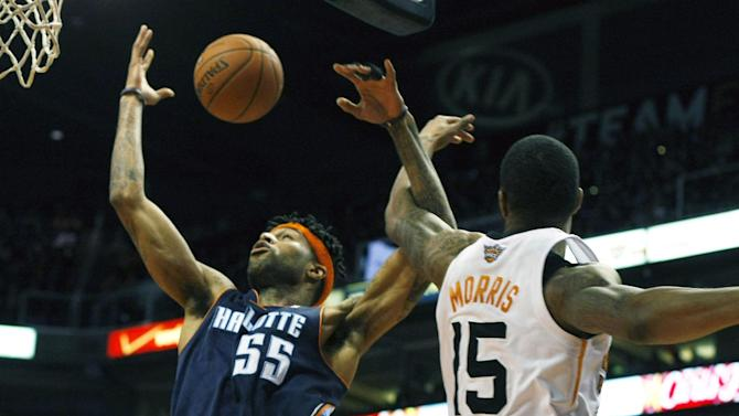 Charlotte Bobcats shooting guard Chris Douglas-Roberts (55) is fouled by Phoenix Suns power forward Marcus Morris (15) in the first quarter during an NBA basketball game on Saturday, Feb. 1, 2014, in Phoenix