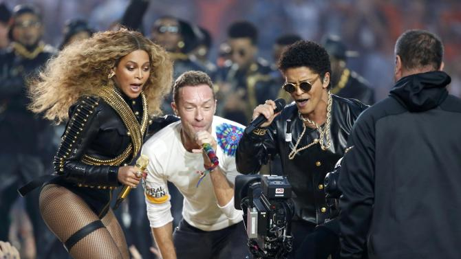 Beyonce, Martin and Mars perform during the half-time show at the NFL's Super Bowl 50 between the Carolina Panthers and the Denver Broncos in Santa Clara