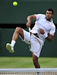France's Jo-Wilfried Tsonga plays a shot during his men's singles semi-final match against Britain's Andy Murray. Murray won 6-3, 6-4, 3-6, 7-5