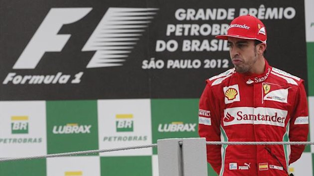 Second placed Ferrari Formula One driver Fernando Alonso of Spain looks on at the podium after the Brazilian F1 Grand Prix at Interlagos circuit in Sao Paulo