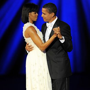 Michelle Obama wore winter white at the inaugural balls. (Getty)